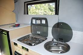 rv stove top and sink with covers